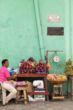 A fruit vendor on Granada's Calle Real Xalteva.
