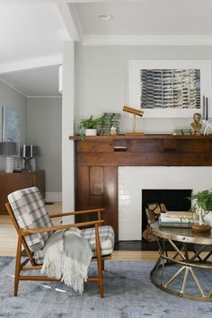 I love the original dark wood with the painted brick fireplace. And I love that the fireplace divides the rooms. If only it was a working fireplace. Home Living Room, Living Room Decor, Living Spaces, Mantel Styling, Home Interior, Interior Design, Fireplace Surrounds, Wood Fireplace, Fireplaces