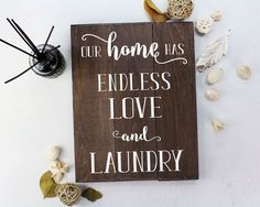 """Our Home Has Endless Love and Laundry : A great home decor sign for a busy household with lots of love. FEATURES: Size is 11"""" x 14"""" Handmade at our sign studio Solid wood with dark stain White painted"""