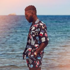 UK rapper Tinie Tempah for MR PORTER wearing Maison Kitsuné Camp-Collar Printed Cotton-Poplin Shirt and Maison Kitsuné Mid-Length Printed Swim Shorts.