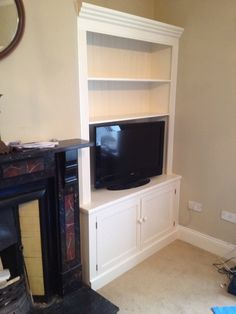 Solid pine painted fitted alcove unit. Fits Perfectly, because it's made to measure....