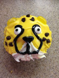 Cheetah Cupcake for Viviana's 5th birthday - mini chip spots, jellybean ears, candy eyes.