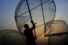 GOLDEN HOUR: A fisherman loaded his boat with traps near the Persian Gulf seashore in the fishing village of Malkiya, Bahrain, Monday. (Hasan Jamali/Associated Press)