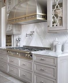 Gorgeous Kitchen-Great range, hood, and love the style and color of cabinets.
