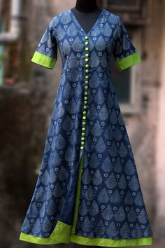 a long kurta with indigo & white print, short sleeves and lime green steel buttons! the main fabric is handblock printed fabric using natural dyes from ba