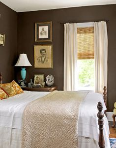 chocolate brown master bedroom. like the rattan blinds with long panels and touch of aqua with the lamp - woven wood shades