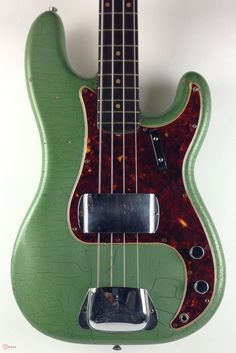 Super cool and fantastic playing / sounding 1961 Fender Precision Bass. As shown the bass has been refinished ages ago in what appears to me to be a heavily faded / greened Ice Metallic Blue. Fender Bass Guitar, Fender Guitars, Vintage Bass, Vintage Guitars, I Love Bass, Fender Precision Bass, All About That Bass, Bass Amps, Guitar Collection