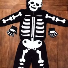 I made this costume using a black sweat suit and cut out white felt bone. I attached the bones with fabric glue. I got the bones pattern from ... & Skeleton Costume - DIY Halloween Costume | Cool decorating stuff ...
