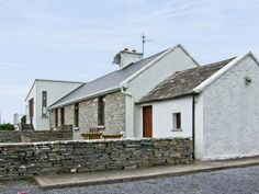 Cahilly Cottage - A delightful Irish cottage which has been lovingly renovated. Open fire, elevated sun room, sea views, close to Cliffs of Moher. Irish Cottage, Open Fires, Sunroom, Cabin, Mansions, House Styles, Outdoor Decor, Celtic, Ireland