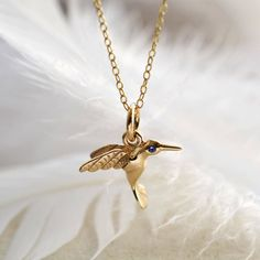 This Limited Edition solid 9 carat gold hummingbird necklace comes kissed with a diamond, ruby or sapphire. Add your special message for the perfect gift.