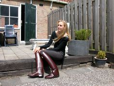 Blonde modeling gorgeous maroon riding boots