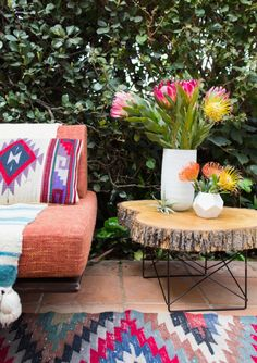 Amp up your patio with navajo textiles and a stump side table.