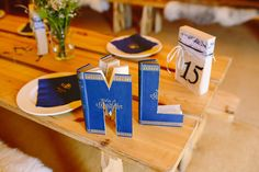 Antique books crafted into DIY initials - Image by Paper Angel Photography - Vivienne Westwood Bridal Gown For A Buddhist Outdoor Wedding In Worcestershire With Bridesmaids In J Crew And Images From Paper Angel Photography