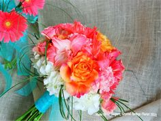 """Wedding bouquet - White hydrangeas,""""freespirit"""" roses, bear grass, coral galds, coral spray roses, peach carnations, and coral gerbera daisies"""