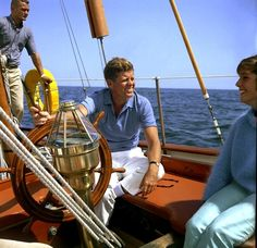 Kennedy sitting on the U.S. Coast Guard yacht Manitou off Narragansett Bay. The president was vacationing at Hammersmith Farm in Newport.