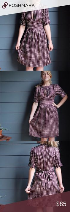 """BCBGMAXAZRIA RETRO DRESS Adorable BCBGMAXAZARIA Retro style dress! Featuring polka dots and a beautiful wine color!               • Brand New With Tags!                                                      • Size XS                                                                                       • Color: Merlot/Cream                                                           • Length 35"""" • Width across waist 15""""                                   • Features a tie at the waist that ties…"""