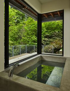 Large concrete Japanese soaking tub that looks out into the forest. One day, Jen, one day.