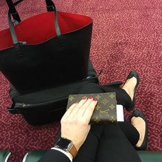 Simple travel outfit: black suit, repetto ballerina, mansur gavriel tote, apple watch, louis vuitton passport cover (from yasmin_dxb instagram)