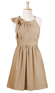 Bow tied neck poplin dress  STYLE # CL0021662  $54.95  Color: Beige brown  A cotton poplin dress is fashioned with a pleated neckline and cutaway shoulders. A wide band emphasizes the natural waist.  Slips on over head; partial side zip closure.  Wide sash tie loops through the neckline and ties at side.  Gathered bodice and skirt.  On-seam pockets.  Above knee length.  100% Cotton, woven poplin, no stretch, mid-weight.  Machine wash.