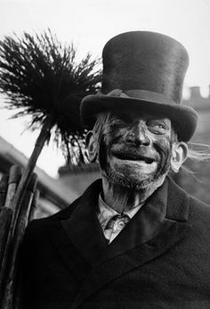 91 year-old chimney sweep Titch Cox smiling on a London rooftop, 30th December 1969. (Photo by Popperfoto/Getty Images).
