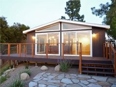 www.artenzo.com wp-content uploads 2016 10 Flagstone-Walkway-and-Glass-Windows-for-Cottage-Modern-Contemporary-Prefab-Homes-with-Glass-Wall-and-Raised-Deck-800x602.jpg