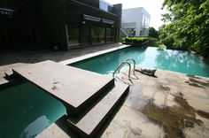 This pool, at a Richard Meier-designed house in Armonk, leads to a waterfall and a spa beneath.