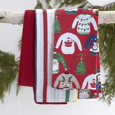 "Add to your holiday kitchen decor with a set of Harman Christmas Combo Cotton Kitchen Towels. These ""Ugly Sweater"" set of 3 towels are finished in Santa red and will keep you dry - and festive this Christmas Season.    Whether you're looking for stocking stuffers, Secret Santa presents, festive Christmas decor or even gift cards, we have a huge selection of unique holiday stuff to make your days and nights merry and bright."