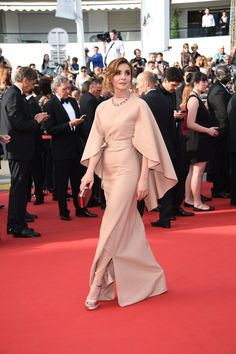 "Clotilde Courau in a Valentino Haute Couture gown from the Fall/Winter 2014-15 during the Opening Ceremony of the 68th Cannes Film Festival and ""La Tete Haute"" Premiere, on Wednesday May 13th, 2015."