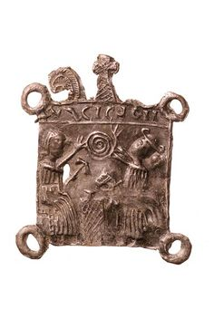 Pilgrim badge of St Eloi. St Eloi was a French saint, born around 588. This badge shows St Eloi on the left, hammering on an anvil. On the right are a horse and a pilgrim giving St Eloi a trindle (a coiled candle). Above is a misspelt inscription: 'ELIGIUS'. Late 13th century | Museum of London