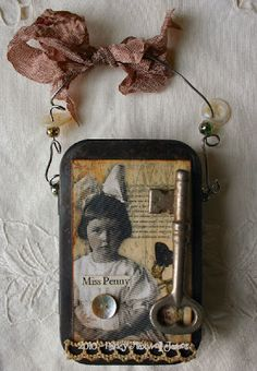 This is Miss Penny...a rustic altered tin. Hubby helped with the aging process (small bonfire in our fire pit) which adds a wonderful patina to the tin. I then added wire with beads and mother of pearl buttons as embellishments. The tin has been collaged on both sides using Paper Whimsy Collage