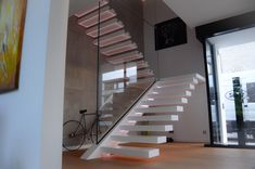 Staircase design ideas from modern to classic. Siller designs stairs custom made for your requirements. Siller does design stairs in wood, steel, glass, acrylic and other materials. Glass Stairs, Floating Stairs, Showroom, Cantilever Stairs, Corian, Led, Staircase Design, Modern Architecture, Steel