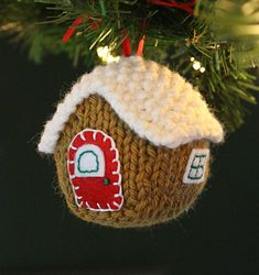 The Little Gingerbread House knitting pattern by Fifty Four Ten Studio.  Felt applique for windows and doors. Fun Christmas ornament pattern.