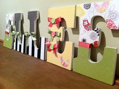 Large wood hanging wall letters custom personalized for nursery kids room matches fabric from bedding like Kidsline and pottery barn kids