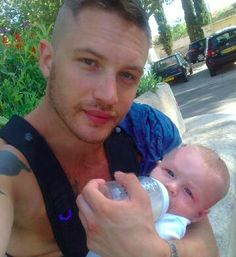 Michelle...As if you didn't already love him enough.   How about this photo of Tom Hardy and baby Louis with their matching blue eyes? | 17 Hot Celebrity Dads And Their Babies To Brighten Up Your Day