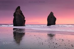 Two sisters - Probably the most beautiful sunset i have seen in my life. It was in Tongaporutu Three Sisters beach (three in the past, now only two of them left), in the north island of New Zealand. Was waiting the tide to come down and let me go to the viewpoint where i took the photo. As the sky started to get amazing colours, i have to take out my shoes and walk carefully by the water. I didn`t expect to find that hole where i suddenly got mysenlf until hip. Lost mobile phone but not…