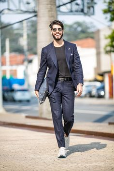 Mens Street Style: Kadu Dantas is armed for seduction with the Fauré Le Page Pochette Zip in Paris Blue.