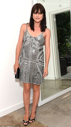 Still got it! The 35 year-old wowed party-goers in a metallic sequinned dress, which not o...