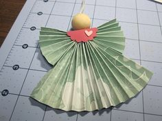 Tutorial on how to make folded paper angels using designer paper.