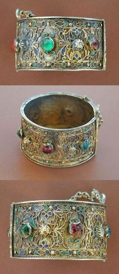 Tunisia | Antique silver-gilt and enameled hinged bracelet, from Djerba | Silver-gilt and enamel and colored glass cabochons. | Late 19th, early 20th century | 440$