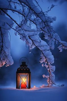 Lantern candle in the blue snow mist.