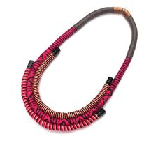 This striking statement bib necklace adds a very special dimension to your outfit !    The piece features polyester rope, wrapped with black & pink