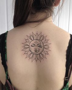 black and gray sun and moon tattoo