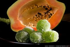 Paw Paw Balls ---  3 cups green paw paw (papaya), grated  2 1/2 cups granulated sugar  1/2 tsp green colouring  2 tsp lime juice  1 cup water