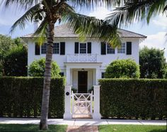 White with black shutters, hedge privacy wall - J K Kling Associates
