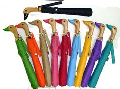 The perfect way to stay dry; whether your making way for ducklings or just walking to work. This traditional wooden duck head high quality umbrella is durable and fully water resistant. NRO® Duck Umbrellas are available in Lilac, Teal, Apple Green, Peony Pink, Red, Tan, Yellow, Sky Blue, Orange 25