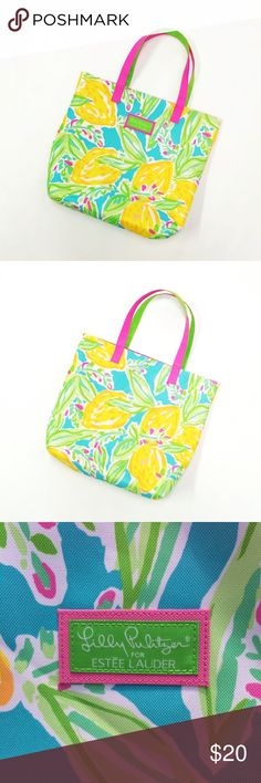 Lilly Pulitzer tote bag We all need bags to put our hot sauce in, why not make it a cute one! Lilly Pulitzer for Estée Lauder. Pink and green handles. Lemon print on a blue background.    No trades.  Offers only accepted through the offer feature.  Bundles will only be made using the bundle feature. Lilly Pulitzer Bags Totes