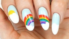 Natasha Lee creates a simple rainbow and cloud nail art design that requires no tools — just the brush from the polish bottle. White Nail Polish, White Nails, Nail Art Diy, Easy Nail Art, Nail Polish Designs, Nail Art Designs, Hair And Nails, My Nails, Lgbt