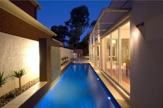 Pool Ideas. Close proximity to house. Large windows overlooking pool. Raised garden bed adjacent to fence. Lighting.