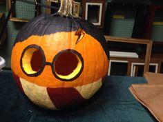 Cheap, easy, simple way of having a very Harry Halloween. Tools Used- pumpkin, $5 carving kit, and acrylic paints ($0.50 a bottle) all from Wal-Mart. Harry Potter Pumpkin Idea