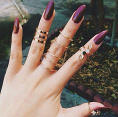 Almond nails in a deep burgundy.